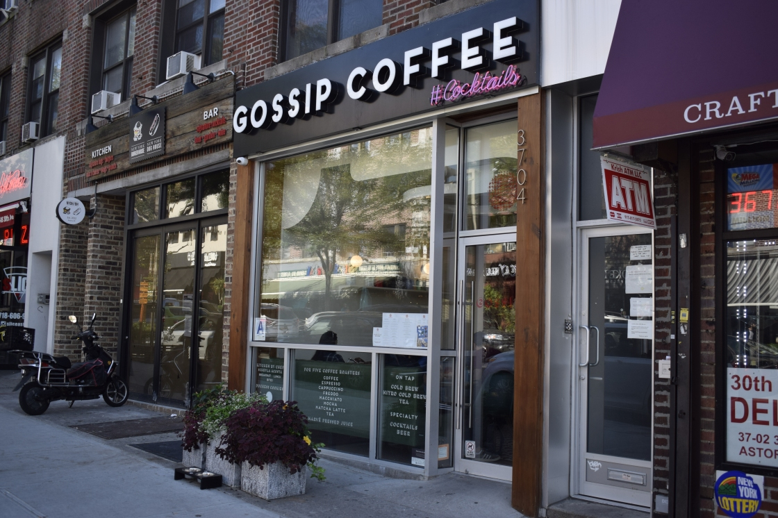Storefront of Gossip Coffee and Cocktails in Astoria with new sign