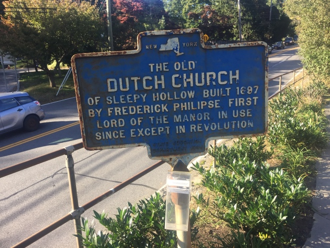 "Sign outside of the Old Dutch Church that says ""The Old Dutch Church of Sleepy Hollow Buil 1687 by Frederick Philipse First Lord of the Manor in Use Since Except in Revolution"