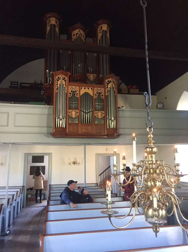 Interior of the Old Dutch Church in Sleepy Hollow, NY with Chandelier, Pulpit, Organ, and carved pumpkins for Halloween