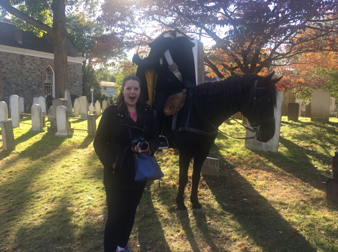 Headless Horseman stands over Sleepy Hollow Cemetery visitor with a sword