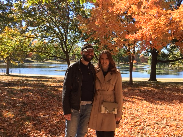A couple under fall foliage in Washington, DC