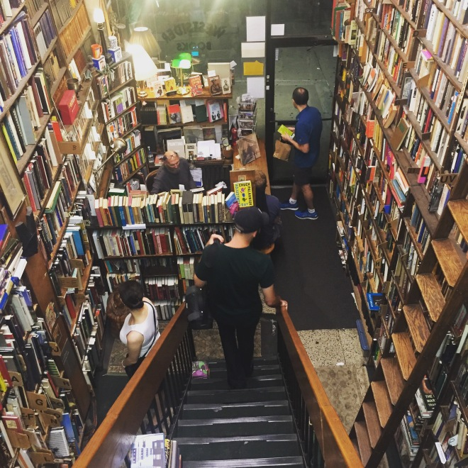 Man descending staircase of Westsider Books in Manhattan